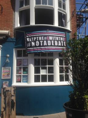 Brighton pub with 'no debate' banner
