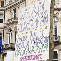 Placard: Trust me, I have a degree in geography