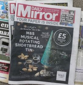 Daily Mirror cover covered by wraparound ad
