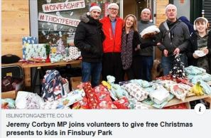 Snap from the Islington Gazette - corbyn distributing Christmas presents to kids in Finsbury Park