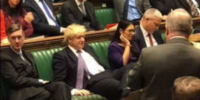 Boris Johnson and his motley crew lying around on the front bench in parliament