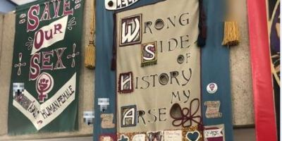 Banners: 'save our sex' and 'wrong side of history my arse'