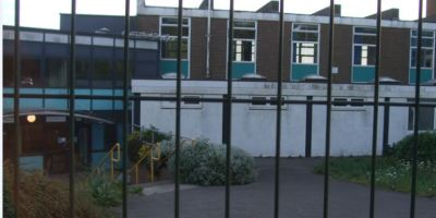 The front entrance to Helenswood school, seen through barriers