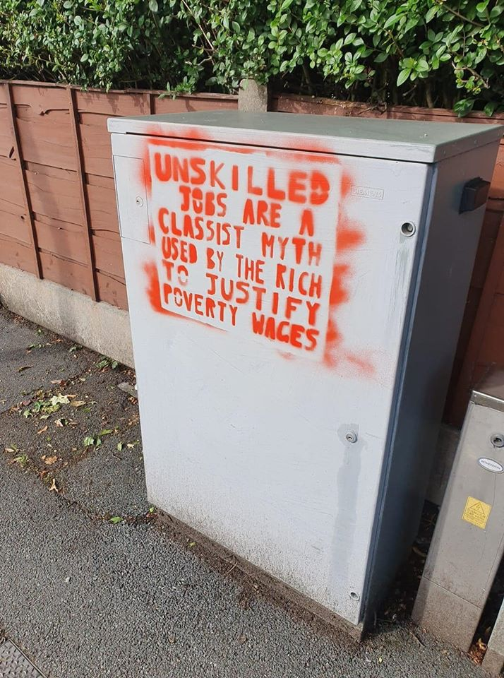 Stencil on a street in Manchester: Unskilled jobs are a classist myth used by the rich to justify poverty wages