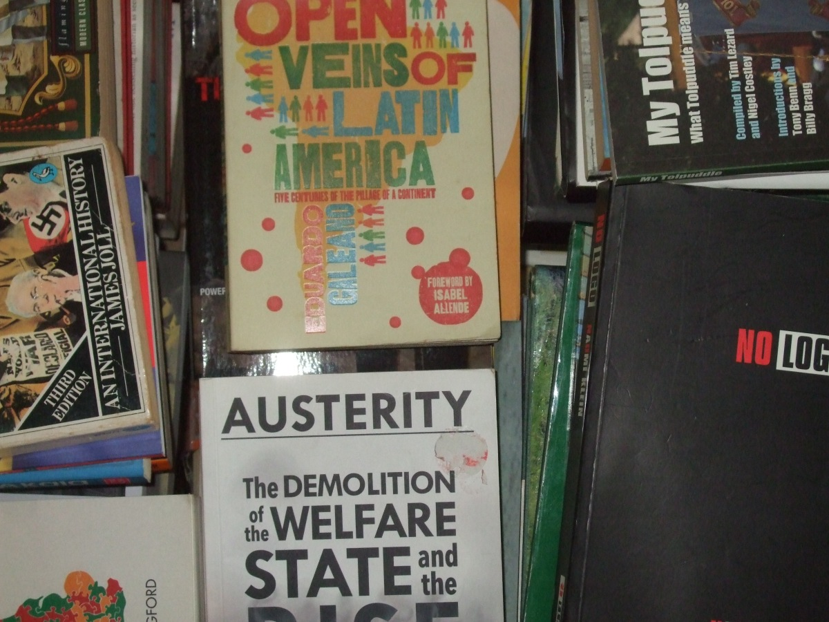 Pile of political books, with 'the Open Veins of Latin America' on top